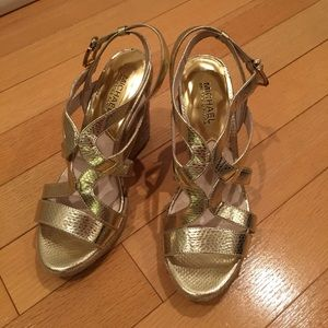 Slightly used Michael Kors wedge sandals.